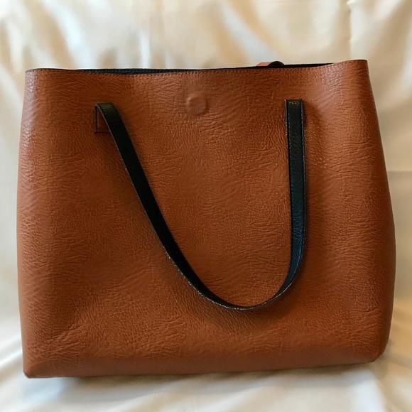 0b1f831760cc Free People Handbags - Free People Reversible Slouchy Vegan Leather Tote